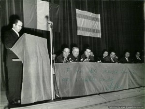 Menachem Begin speaking with Isidore Franckel at a conference