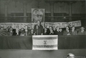 Isidore Franckel speaking at a conference with Menachem Begin on the right